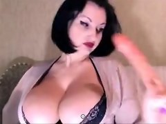 A Busty Brunette Removes Her Clothes video on WebcamWhoring.com