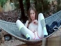 Russian cutie Gloria rubbing bald pussy outdoor video on WebcamWhoring.com