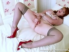 Busty mature redhead strips off panties finger fucks toys in retro open bra nylons heels garters video on WebcamWhoring.com