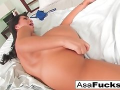 Asa Akira fingering herself and playing with her pink toy in her bed video on WebcamWhoring.com