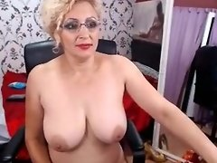 Voluptuous blonde housewife in stockings touches herself fo video on WebcamWhoring.com