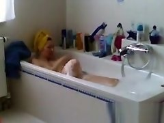 Spied my Mom shaving her pussy in bath video on WebcamWhoring.com