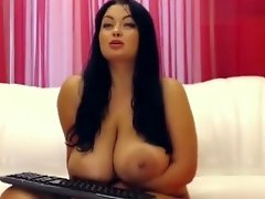 Plump brunette Tammila rubs her tits with oil video on WebcamWhoring.com